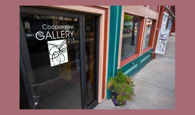 Photo of the Cooperative Gallery 213 logo on the front door