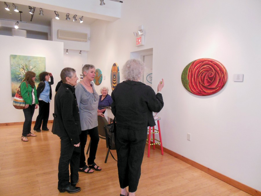 Group of people viewing artwork in the gallery